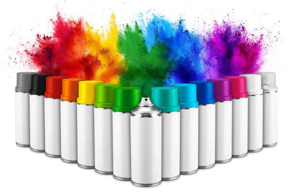 row of many spray can in colorful color in front of rainbow